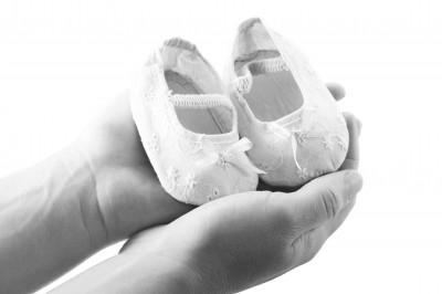 Hands Holding Baby Shoes FreeDigitalPhotos.net